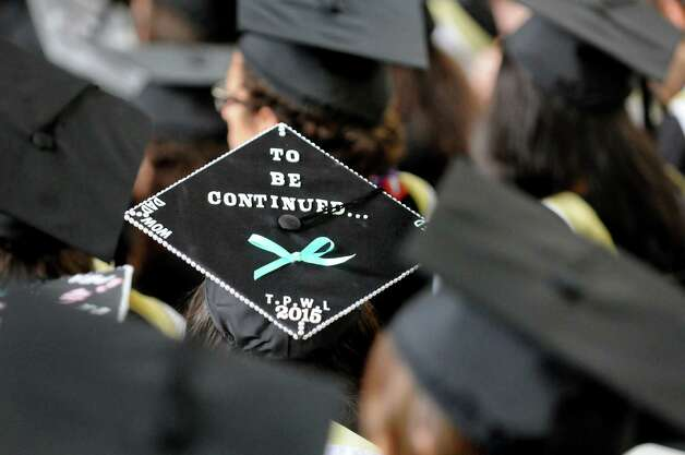 A graduate sends a message via her mortar board during Skidmore College commencement exercises on Saturday, May 16, 2015, at Saratoga Performing Arts Center in Saratoga Springs, N.Y. (Cindy Schultz / Times Union) Photo: Cindy Schultz / 00031514A