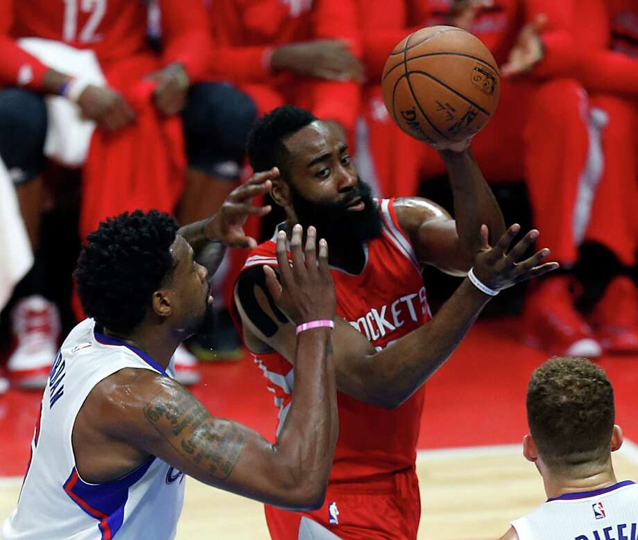 Rockets guard James Harden, center, looks for an open teammate against the defense of the Clippers' DeAndre Jordan, left, and Blake Griffin in Game 6. Harden had a poor night from the floor, going 5-for-20. Photo: Karen Warren, Staff / © 2015 Houston Chronicle