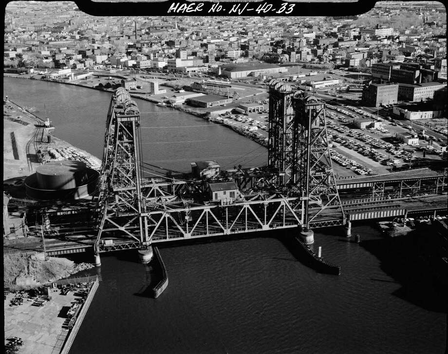 This circa 1968 photo made available by the Library of Congress shows the Dock Bridge over the Passaic River in Newark, N.J. along the Northeast Railroad Corridor. The rails of the Northeast Corridor are decaying, increasingly strained, and moving more people than ever around the nation's most densely populated region. (Library of Congress via AP) Photo: HOGP / Library of Congress