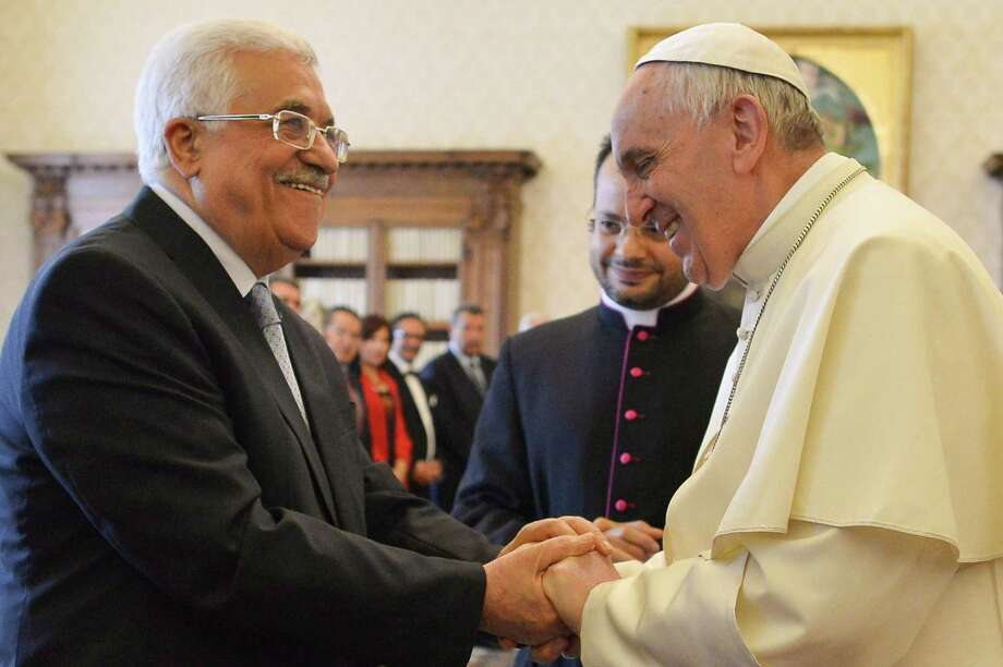 "Pope Francis, right, met with Palestinian authority President Mahmoud Abbas Saturday at the Vatican, where Francis praised Abbas as an ""angel of peace.""  Photo: ALBERTO PIZZOLI, POOL / POOL"