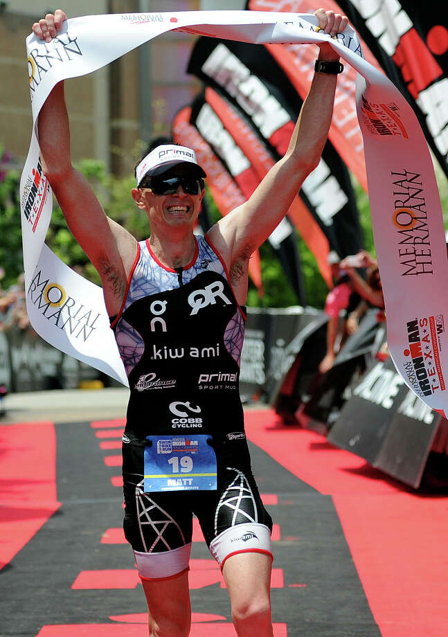 There was much to smile about for triathletes Matt Hanson and Angela Naeth, who won their respective professional divisions Saturday. Photo: Eric Christian Smith, Freelance / 2015 Eric Christian Smith