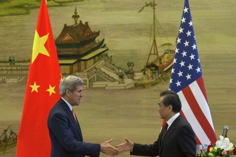 BEIJING, CHINA - MAY 16:  U.S. Secretary of State John Kerry and Chinese Foreign Minister Wang Yi shake hands after a press conference following meetings at the Ministry of Foreign Affairs on May 16, 2015 in Beijing, China. U.S. Secretary of State John Kerry is urging China to halt increasingly assertive actions it is taking in the South China Sea. (Photo by Ng Han Guan - Pool/Getty Images) *** BESTPIX *** Photo: Pool, Pool / 2015 Getty Images