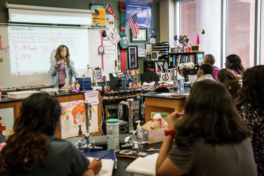 FILE - Chemistry teacher Charlie Taylor talks to her class of freshman and sophomores at Judson Early College Academy in San Antonio on Thursday, May 7, 2015. Judson ISD trustees decided to raise salaries for all its employees, two months after the board balked at the idea due to budget constraints.Click ahead to view the highest average teacher salaries at San Antonio-area high schools in 2017, according to Niche. Photo: Matthew Busch, For San Antonio Express-News / For San Antonio Express-News / © Matthew Busch