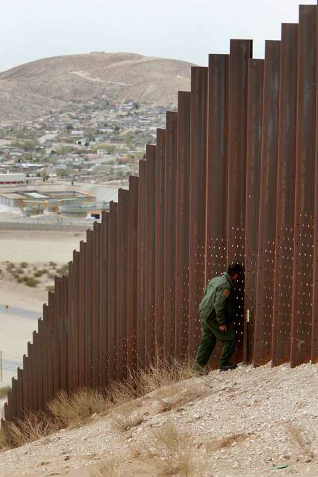 A fence near Sunland Park, N.M., is part of the infrastructure used to deter border crossers. Some say the efforts are working; others are not so sure.  Photo: Mayra Beltran, Staff / 2012 Houston Chronicle