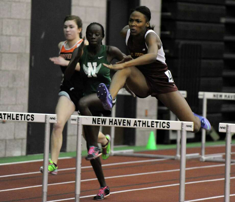 St. Joseph's Jada Harris competes in the 55 meter hurdles Thursday, Feb. 5, 2015, during the FCIAC boys and girls indoor track and field championhsips at the Floyd Little Athletic Center in New Haven, Conn. Photo: Autumn Driscoll / Connecticut Post