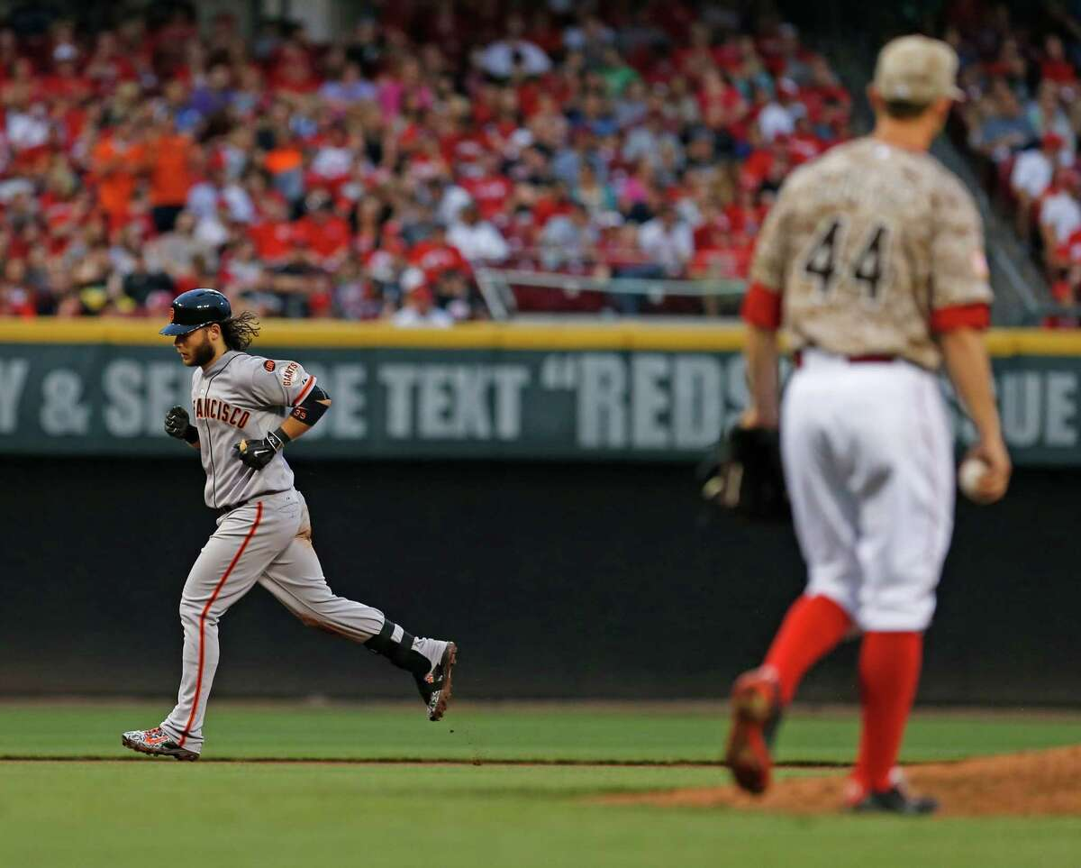 Brandon Crawford circles the bases after connecting for a grand slam off Reds starter Mike Leake in the fifth inning. In was one of three homers by the Giants, who scored a season-high 11 runs.