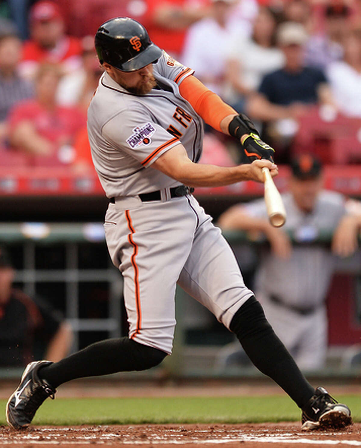 Hunter Pence connects for a double in his first at-bat of the season.