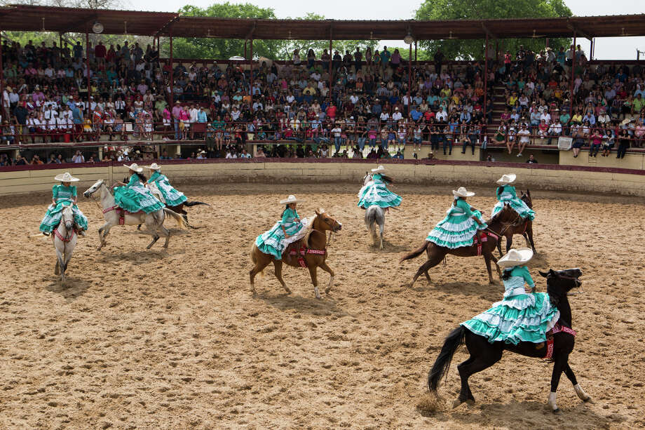 "Escaramuza Las Potrancas does a ""giro"", or a 360 degree spin, during their performance in the ""A Day in Old Mexico"" Charreada at the San Antonio Charros Association in San Antonio, Texas on April 26, 2015. Photo: Carolyn Van Houten / San Antonio Express-News"
