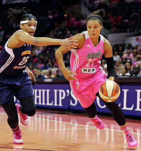 San Antonio Stars' Kayla McBride drives around Connecticut Sun's Alyssa Thomas during first half action Friday Aug. 1, 2014 at the AT&T Center. Photo: Edward A. Ornelas, Staff / San Antonio Express-News / © 2014 San Antonio Express-News