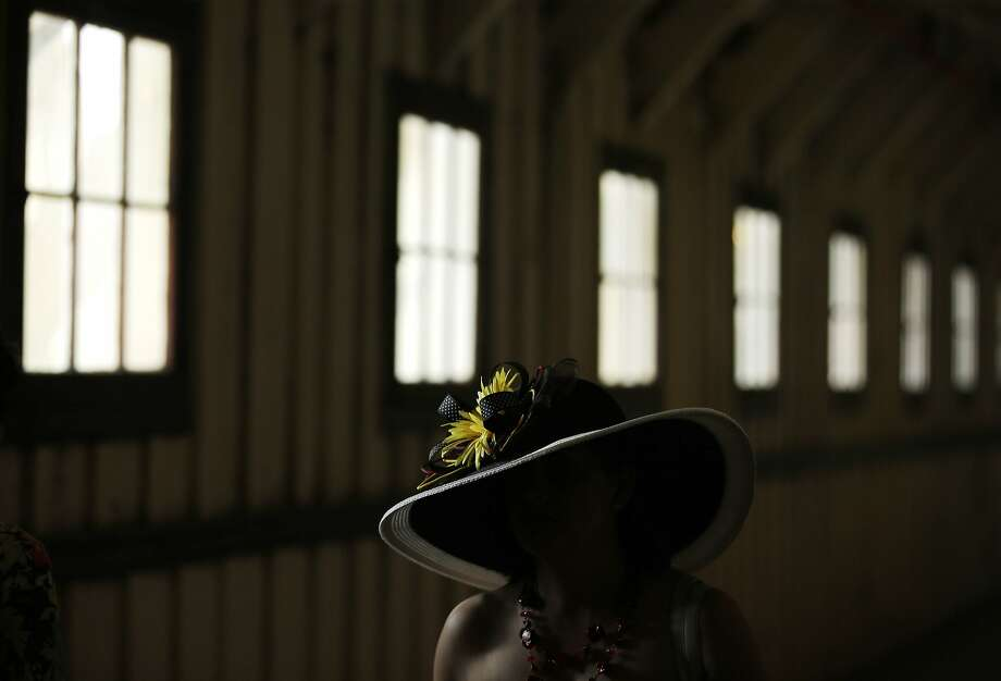 A race fan walks in the concourse before the 140th Preakness Stakes horse race at Pimlico Race Course, Saturday, May 16, 2015, in Baltimore. Photo: Matt Slocum, Associated Press