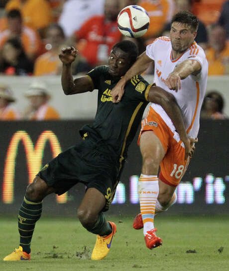 Dynamo defender David Horst, right, and Portland forward Fanendo Adi battle in the first half. Adi scored the Timbers' goal in the second half. Photo: Marie D. De Jesus, Staff / © 2015 Houston Chronicle
