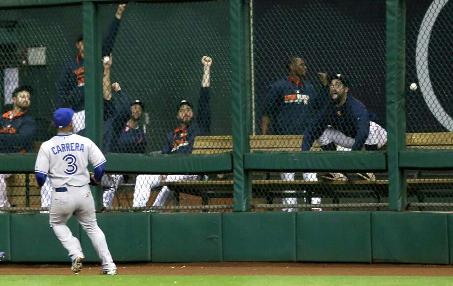 The Astros' bullpen leads the cheers as Blue Jays right fielder Ezequiel Carrera watches the ball go over the fence on a three-run homer by Chris Carter in the sixth inning Saturday night. Photo: Pat Sullivan, STF / AP