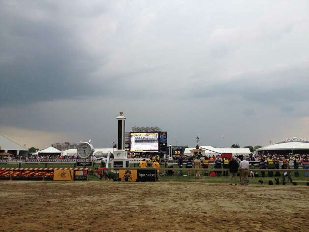 The National Weather Service said it might be a day like this. Preakness Saturday at Pimlico Race Course started out with sunny skies, warm temperatures and a packed house at the track to see American Pharoah run in the second jewel of the Triple Crown. Right before the $1.5 million Preakness was to be run, dark skies engulfed the city of Baltimore and it was only a matter of time before the heavens opened and turned a nice day bad. But, if you liked American Pharoah, things weren't all that bad at all. (Tim Wilkin / Times Union)
