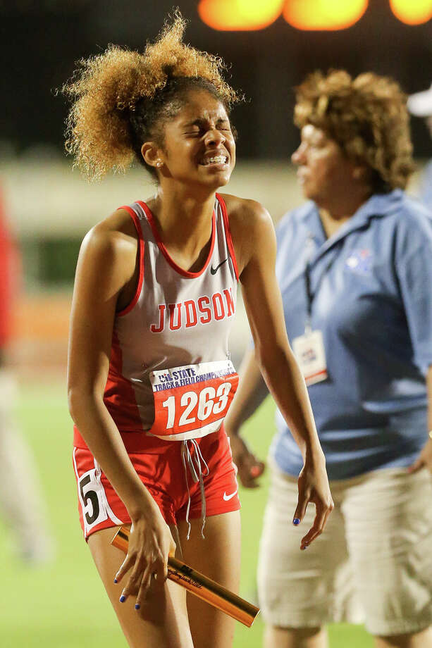 Judson's Mariah Kiykendoll reacts after running the ancor leg on the Lady Rockets 6A 1600-meter relay team during the UIL State track and field meet at Mike Myers Stadium in Austin on Saturday, May 16, 2015.  Judson won the event with a time of 3 minutes, 45.56 seconds, claiming the girls team title at the meet in the process.  MARVIN PFEIFFER/ mpfeiffer@express-news.net Photo: Marvin Pfeiffer, Staff / San Antonio Express-News / Express-News 2015