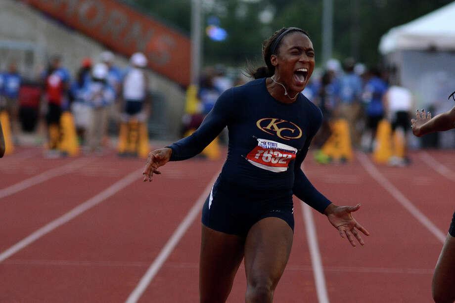 Klein Collins senior Taylor Bennett celebrates winning the girls 100 meters in 11.41 seconds.