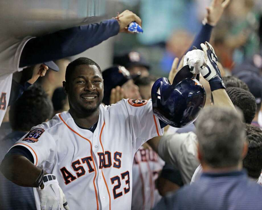 Houston Astros' Chris Carter (23) is congratulated in the dugout after hitting a three-run home run against the Toronto Blue Jays in the sixth inning of a baseball game Saturday, May 16, 2015, in Houston. (AP Photo/Pat Sullivan) Photo: Pat Sullivan, STF / Associated Press / AP