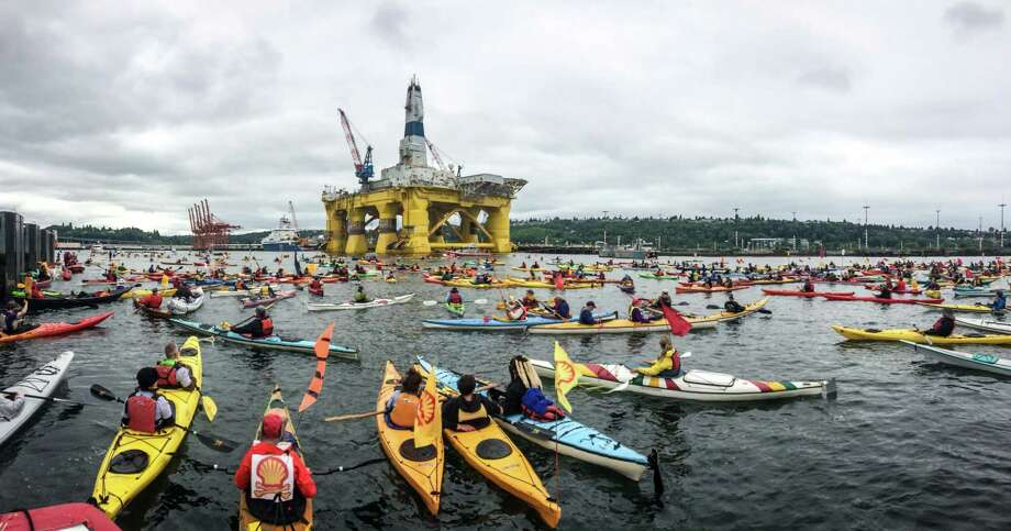 Hundreds of kayaktivists take to the water during protest against drilling in the Arctic and the Port of Seattle being used as a port for the Shell Oil drilling rig Polar Pioneer. The protest flotilla drew many paddlers to show their displeasure with the rig being moored in Seattle. Photographed on Saturday, May 16, 2015. Photo: JOSHUA TRUJILLO, SEATTLEPI.COM / SEATTLEPI.COM