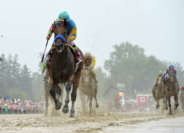 American Pharaoh with jockey Victor Espinoza flies across a very muddy track to win the 140th running of the Preakness Stakes held at Pimlico Race Course Saturday evening May 16, 2015 in Baltimore, MD  (Skip Dickstein/Times Union) Photo: SKIP DICKSTEIN, ALBANY TIMES UNION