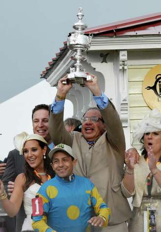 Owner Ahmed Zayat holds the winner's trophy aloft after American Pharaoh won the 140th running of the Preakness Stakes held at Pimlico Race Course Saturday evening May 16, 2015 in Baltimore, MD  (Skip Dickstein/Times Union) Photo: SKIP DICKSTEIN, ALBANY TIMES UNION