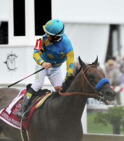Jockey Victor Espinoza looks back for the competition as he goes on to win the 140th running of the Preakness Stakes on American Pharaoh held at Pimlico Race Course Saturday evening May 16, 2015 in Baltimore, MD  (Skip Dickstein/Times Union) Photo: SKIP DICKSTEIN, ALBANY TIMES UNION