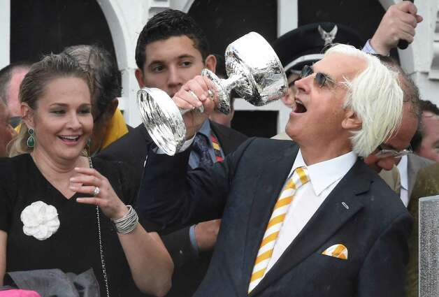 Trainer Bob Baffert enjoys a fun moment in the winner's circle after American Pharaoh with jockey Victor Espinoza flies across a very muddy track to win the 140th running of the Preakness Stakes held at Pimlico Race Course Saturday evening May 16, 2015 in Baltimore, MD  (Skip Dickstein/Times Union) Photo: SKIP DICKSTEIN, ALBANY TIMES UNION