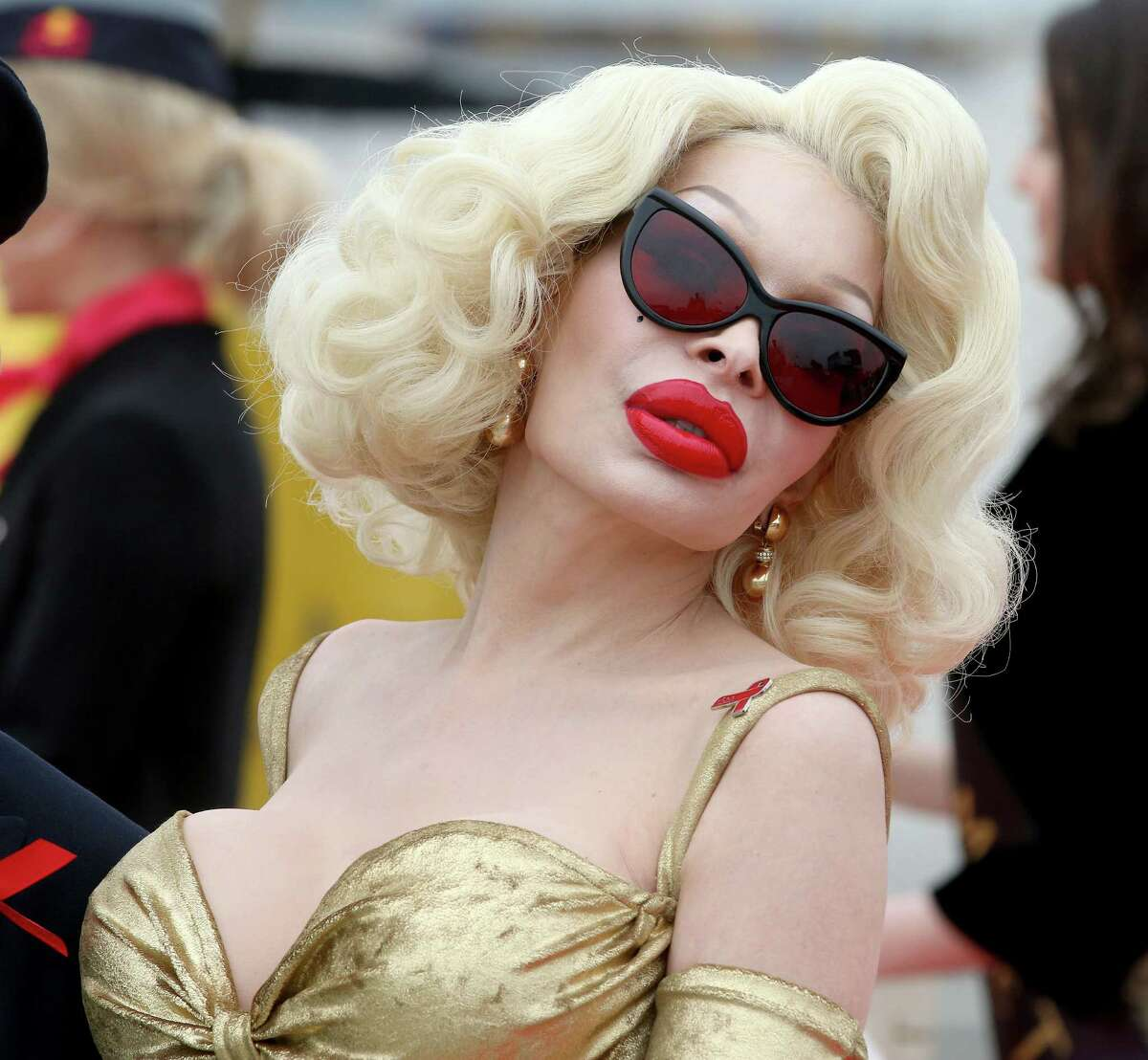 US transgender star Amanda Lepore arrives for the largest annual AIDS charity gala in Europe known as the Life Ball, at the Vienna International Airport near Schwechat, Austria, Friday, May 15, 2015.