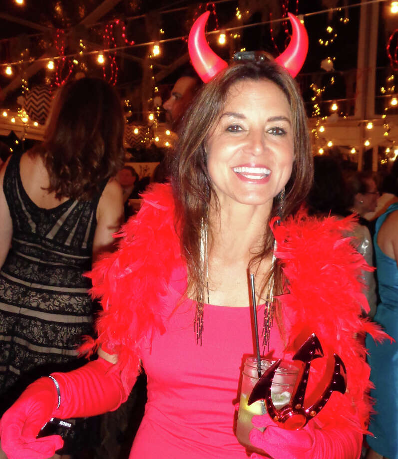 """Taking to heart the Westport Arts Center gala theme, """"Midnight in the Garden of Good and Evil,"""" Stacie Curran of Westport turned out as a devil complete with crimson horns and pitchfork. Photo: Meg Barone / Westport News"""