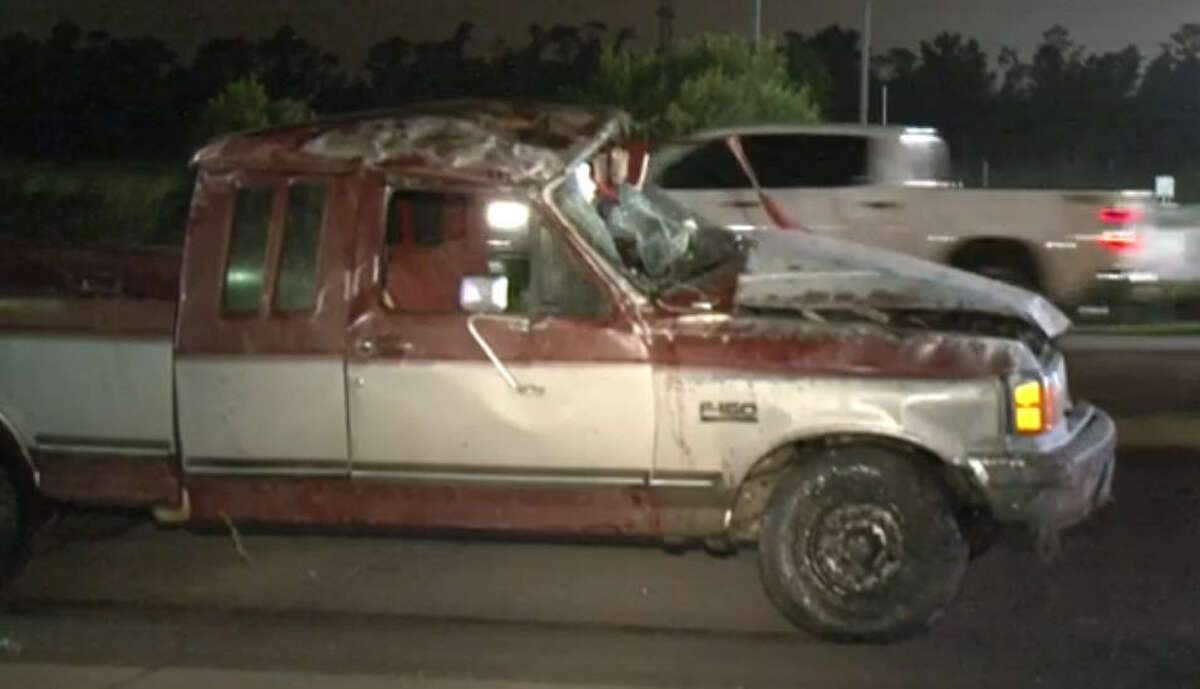 A 60-year-old woman became stuck halfway through the windshield after the pickup truck she was riding in was struck by another pickup that failed to yield at a flashing yellow light, authorities said.