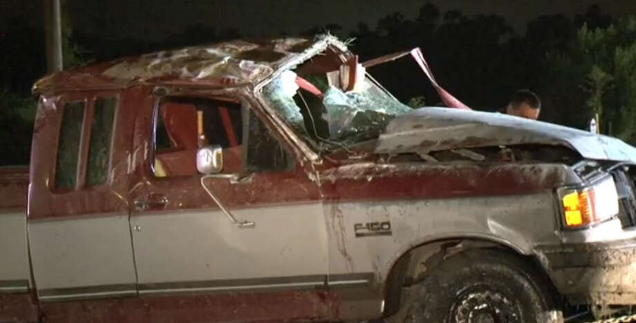 A 60-year-old woman became stuck halfway through the windshield after the pickup truck she was riding in was struck by another pickup that failed to yield at a flashing yellow light, authorities said. Photo: Tim Bristow, Metro Video