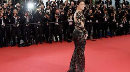 """CANNES, FRANCE - MAY 14:  Michelle Rodriguez attends the """"Mad Max : Fury Road""""  Premiere during the 68th annual Cannes Film Festival on May 14, 2015 in Cannes, France.  (Photo by Samir Hussein/WireImage)"""