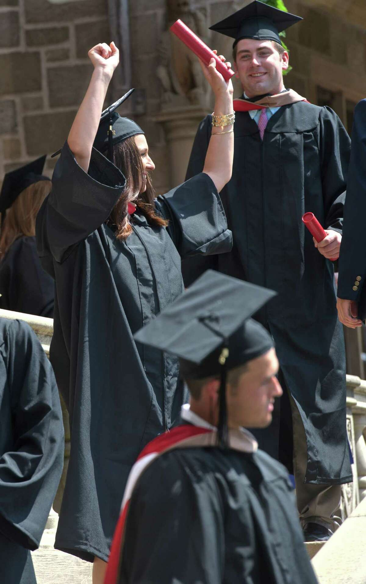Ashley Seaglione, from Long Island, NY, holds up her arms after receiving her diploma during the 2015 Fairfield University Commencement held on the Bellarmine Terrace of Fairfield University, Sunday morning, May 17, 2015, in Fairfield, Conn. Seaglione earned her degree from the Charles F. Dolan School of Business.
