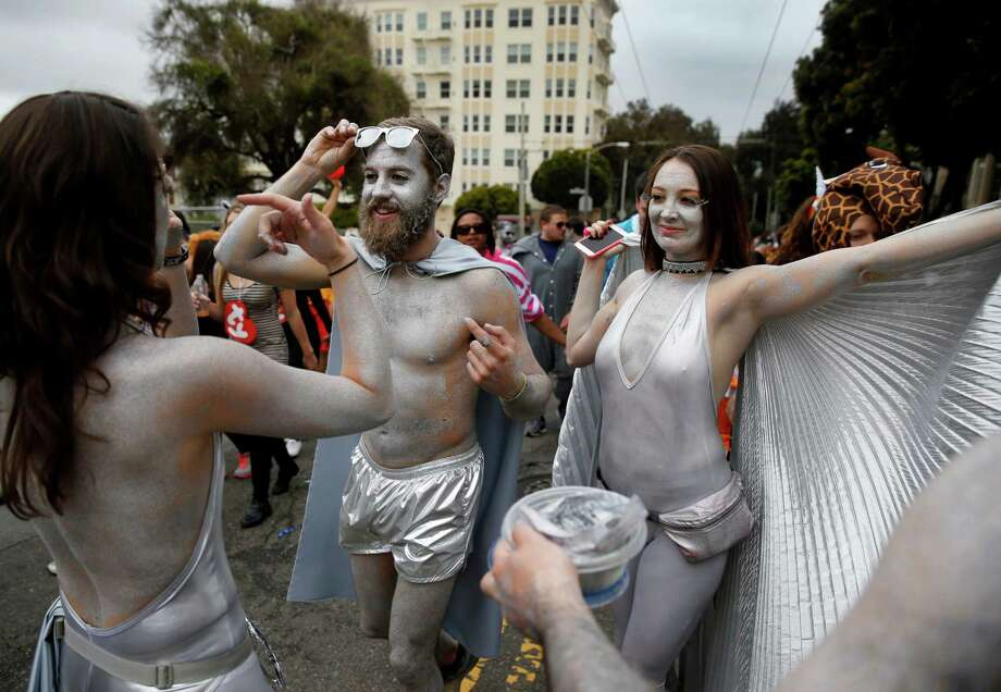 Glitter was the costume for these runners on Hayes Street Sunday May 17, 2015. The zany Bay to Breakers event in the streets of San Francisco, Calif. combined thousands of runners and unique costumes into one big party. Photo: Brant Ward / The Chronicle / ONLINE_YES
