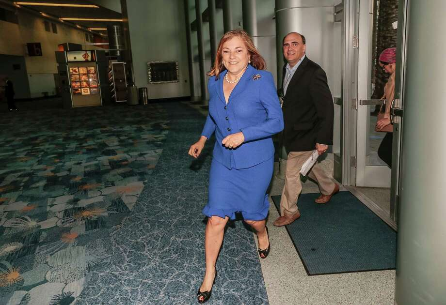 Rep. Loretta Sanchez rushes between events at the California Democratic Convention in Anaheim on Saturday. Photo: Damian Dovarganes / Associated Press / AP