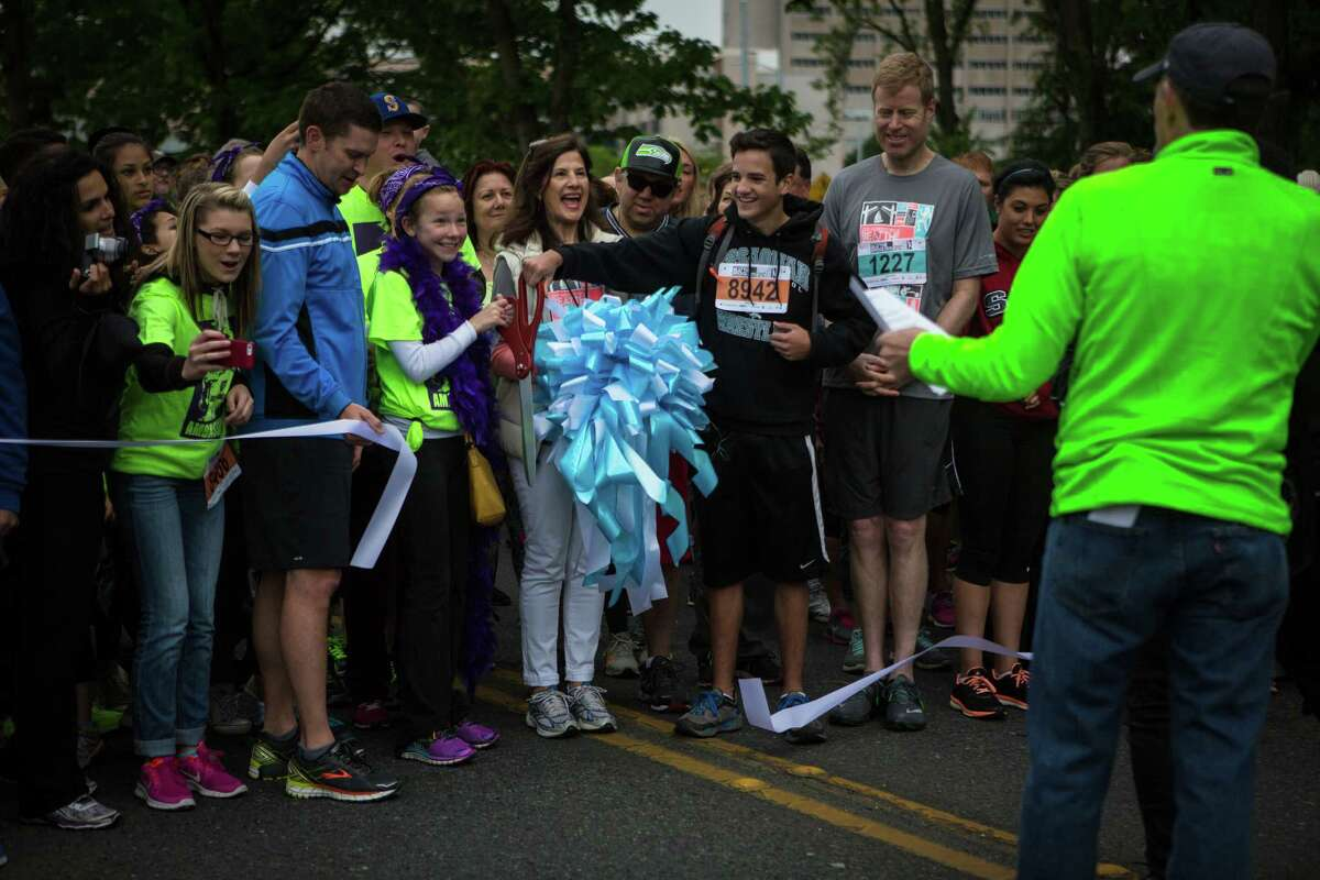 The ribbon is cut at the start ofthe 33rd annual Nordstrom Beat the Bridge race on Sunday, May 17, 2015. Thousands participated in the race and fundraising event for the Juvenile Diabetes Research Foundation that raised over 1.4 million dollars for research. The event consists of an 8K run and wheelchair race, a 4-mile walk, a 1-mile fun run and the Diaper Derby for toddlers.