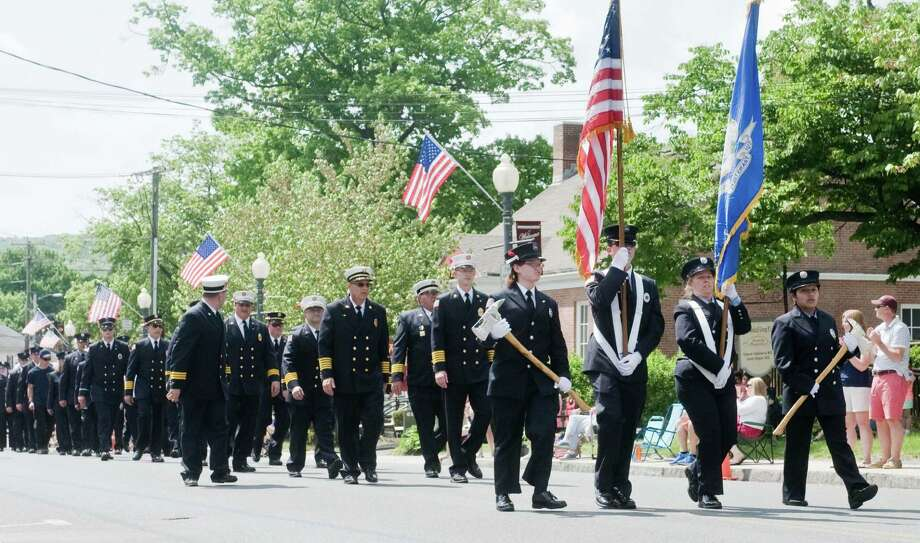 The Bethel Fire Department members marching in the annual Memorial Day Parade on Greenwood Avenue in Bethel. Sunday, May 17, 2015 Photo: Scott Mullin / The News-Times Freelance