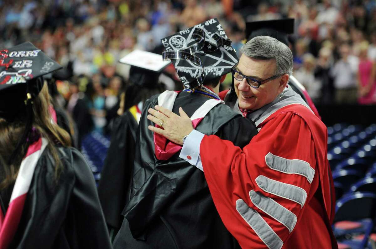 Sacred Heart University President John Petillo, right, greets graduates during the procession at the start of Commencement 2015 at the Webster Bank Arena in Bridgeport, Conn. on Sunday, May 17, 2015.