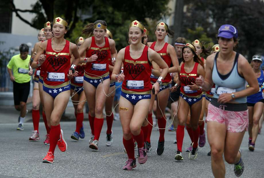 A group of women did the centipede run up Hayes Street Sunday May 17, 2015. The zany Bay to Breakers event in the streets of San Francisco, Calif. combined thousands of runners and unique costumes into one big party. Photo: Brant Ward, The Chronicle