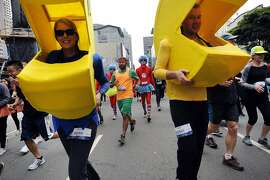 Participants make their way down Howard St. during the running of the 103rd Bay to Breakers event in San Francisco, CA Sunday, May 17, 2015