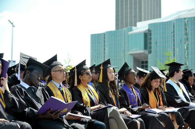 Graduates listen to a speaker during the University at Albany commencement on Sunday, May 17, 2015, in Albany, N.Y.    (Paul Buckowski / Times Union) Photo: PAUL BUCKOWSKI / 00031518A