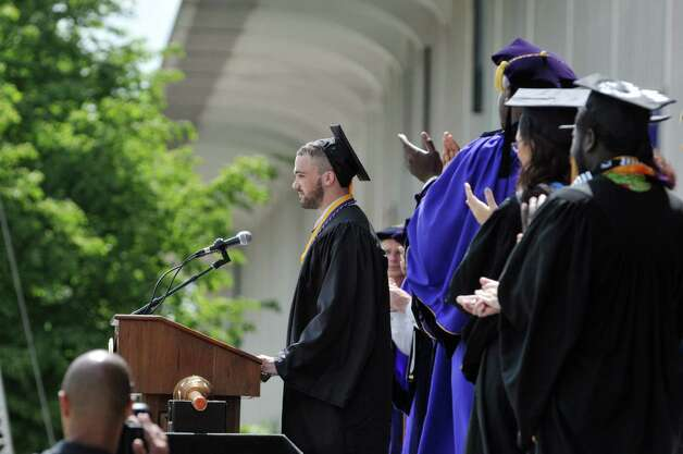 University at Albany basketball player Peter Hooley receives a standing ovation after giving a speech  during the University at Albany commencement on Sunday, May 17, 2015, in Albany, N.Y.    (Paul Buckowski / Times Union) Photo: PAUL BUCKOWSKI / 00031518A