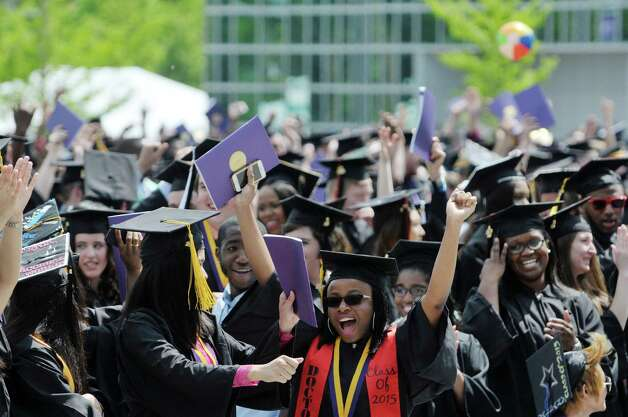 Graduates celebrate as the different programs are called  during the University at Albany commencement on Sunday, May 17, 2015, in Albany, N.Y.    (Paul Buckowski / Times Union) Photo: PAUL BUCKOWSKI / 00031518A