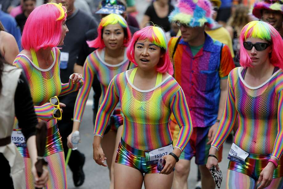 These runners managed to get their hair to match the color of their outfits Sunday May 17, 2015. The zany Bay to Breakers event in the streets of San Francisco, Calif. combined thousands of runners and unique costumes into one big party. Photo: Brant Ward, The Chronicle