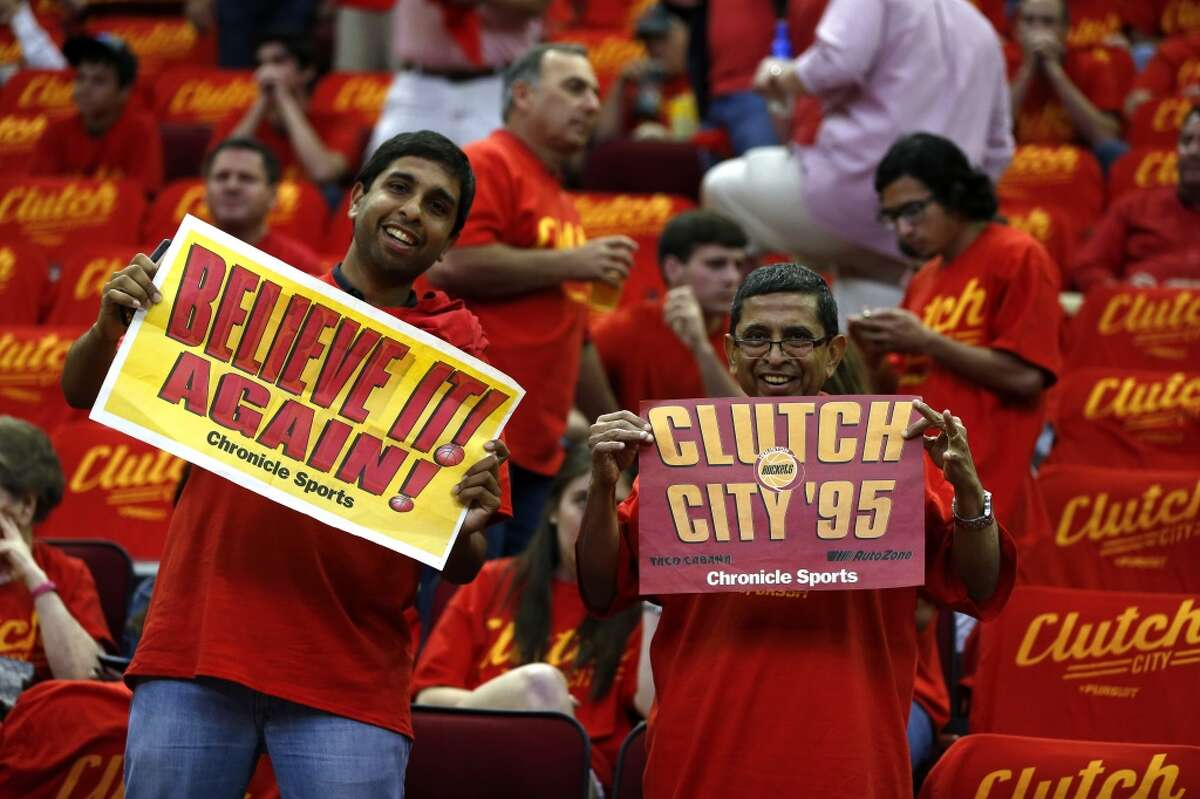 Houston Rockets fans hold up a