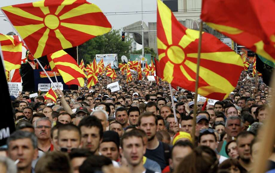 Macedonians wave national flags during an anti-government protest in the tiny, landlocked Balkan nation of about 2 million. Photo: Boris Grdanoski, STR / AP