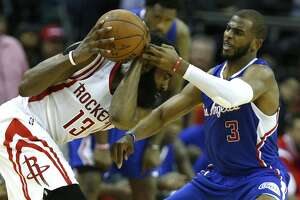 Houston Rockets guard James Harden (13) goes up against Los Angeles Clippers guard Chris Paul (3) during the fourth quarter of Game 7 of the NBA Western Conference semifinals at the Toyota Center Sunday, May 17, 2015, in Houston.  ( James Nielsen / Houston Chronicle )
