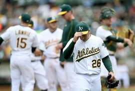 OAKLAND, CA - MAY 17:  Scott Kazmir #26 of the Oakland Athletics walks back to the dugout after being taken out of the game against the Chicago White Sox in the top of the fifth inning at O.co Coliseum on May 17, 2015 in Oakland, California.  (Photo by Thearon W. Henderson/Getty Images)