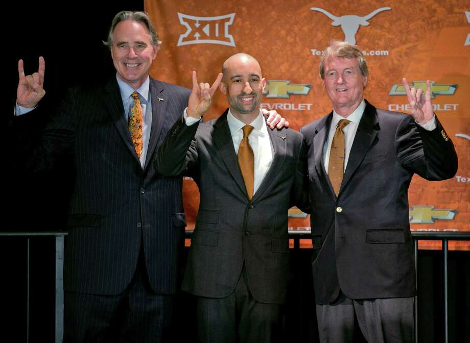 Shaka Smart, middle, is introduced as Texas men's basketball coach at the University of Texas by the school's athletic director. Steve Patterson, left, and president. Bill Powers. Friday, April 3, 2015, in Austin, Texas. (AP Photo/Austin American-Statesman, Jay Janner) Photo: Jay Janner, MBO / Austin American-Statesman