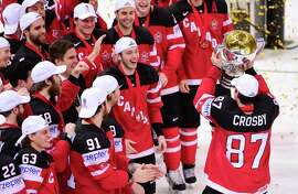 Forward Sidney Crosby (87) shows his Canada teammates the spoils of victory after Canada won the world hockey title in Prague.