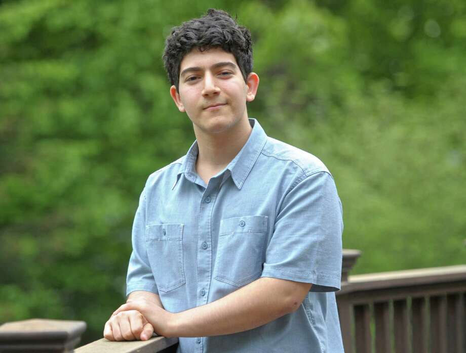 Glenn Unger, a junior at the Wooster School in Danbury, has written an anti-bullying book. Photo: H John Voorhees III / The News-Times