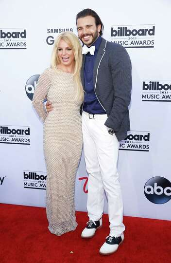 Britney Spears, left, and Charlie Ebersol arrive at the Billboard Music Awards at the MGM Grand Gard